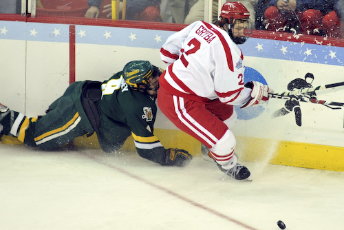 Dean Strong falls trying to keep up with BU's Erik Gryba.